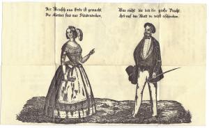 L'immaginetta parzialmente chiusa raffigura i due personaggi completamente vestiti